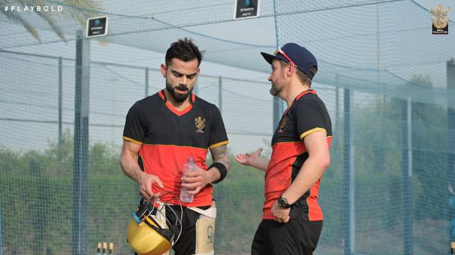 RCB skipper Virat Kohli and director Mike Hesson interacting during training session