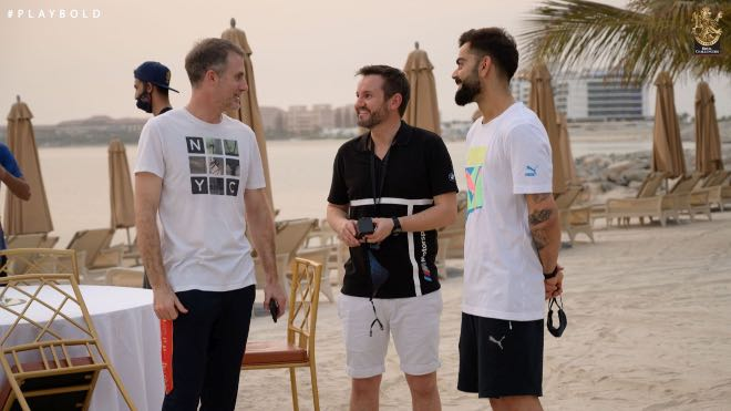 RCB skipper Virat Kohli, head coach Simon Katich and director of cricket Mike Hesson interact with each other